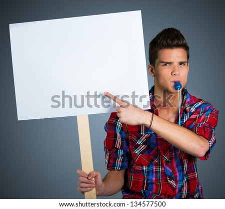 Young man protesting with protest sign - stock photo