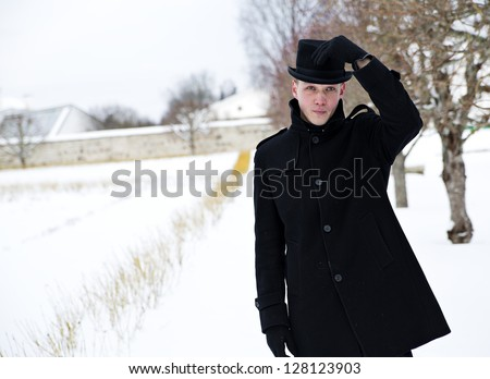 Young man put hat back on his head