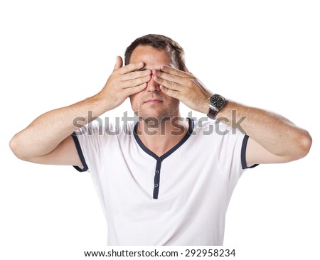 Young man put his hands over eyes isolated on white background - stock photo