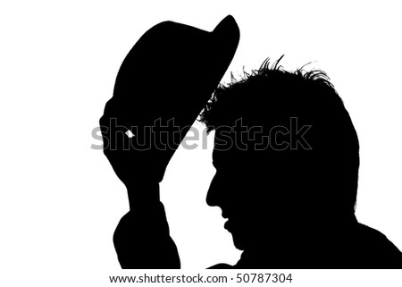young man putting hat on his head ? silhouette - stock photo