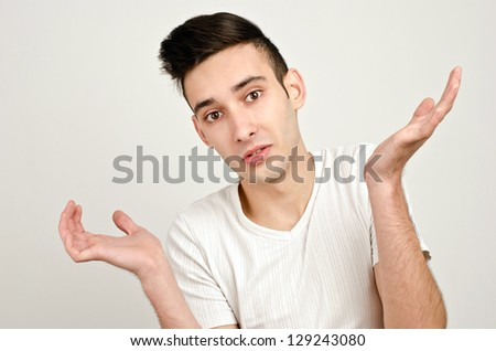 Young man raising his hands wondering. Man with different  facial expressions. - stock photo