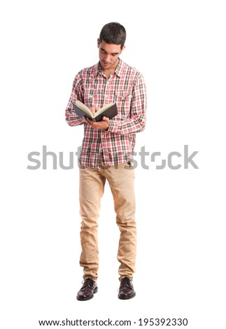 young man reading a book - stock photo