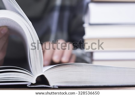 Young man reading a book. - stock photo