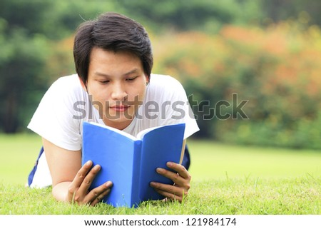 Young man reading a book in outdoor