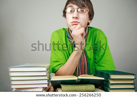 young man reading a book, the student - stock photo