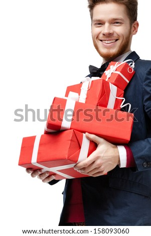 Young man received a lot of presents in red packaging, isolated on white - stock photo