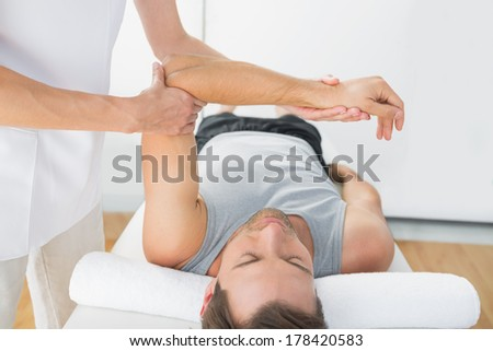 Young man receiving hand massage at health spa
