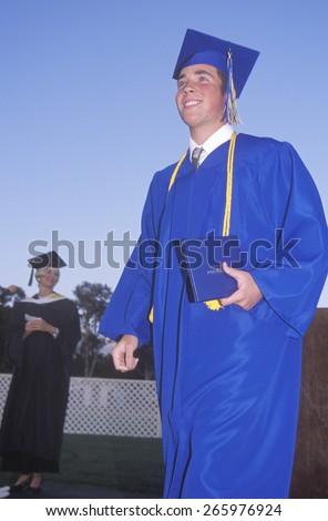 Young man receiving his high school diploma, Nordhoff High School, Ojai, CA - stock photo