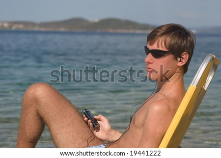 young man relax on the beach