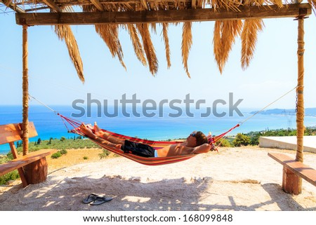 Young man relaxing in a hammock on the island of Zakynthos, Greece - stock photo