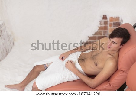 Young man relaxing in the salt room - stock photo