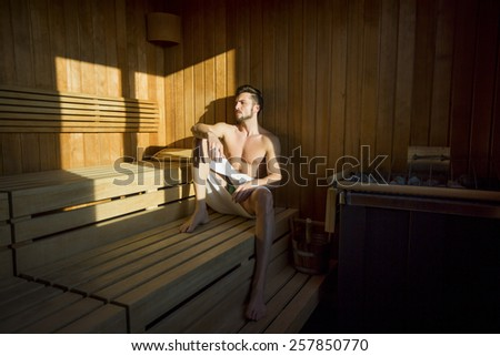 Young man relaxing in the sauna - stock photo