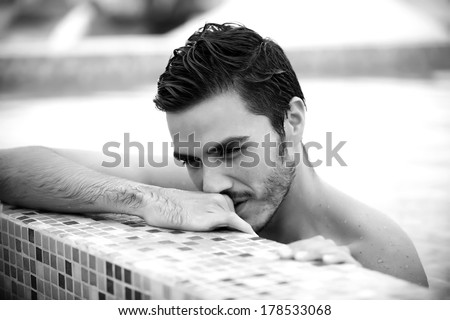 Young man relaxing on a luxury rooftop - stock photo