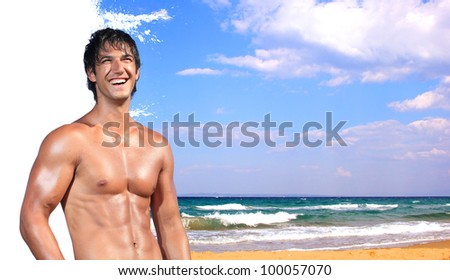 young man relaxing on the beach - Travel concept