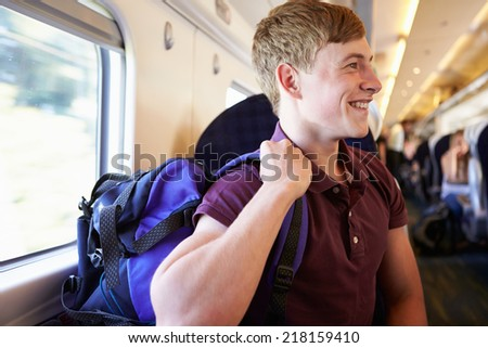 Young Man Relaxing On Train Journey - stock photo