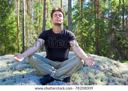 Young man resting in forest. - stock photo