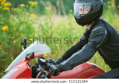 Young man rides nice bike on the road. - stock photo