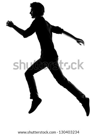 young man  running silhouette in studio isolated on white background - stock photo