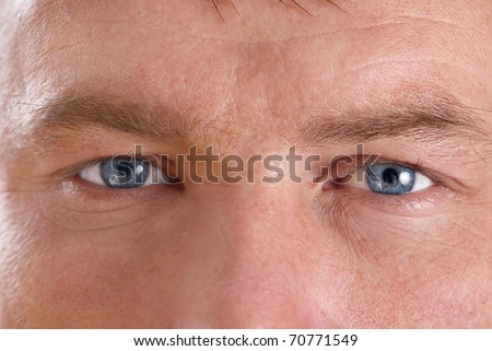 Young man's face. Close up macro portrait - stock photo