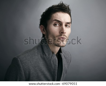 Young man's face. Close-up portrait. - stock photo