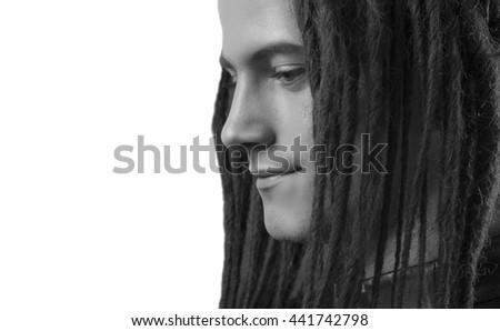 Young man's portrait. Stylish handsome sexy Guy with Dreadlocks on a white background, Close-up face. Black and white. Trendy youthful man's look. Handsome caucasian cool rasta, space for text - stock photo