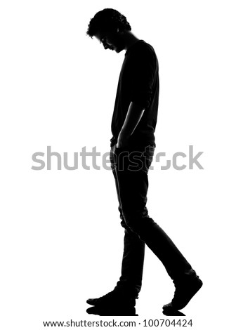 young man sad walking silhouette in studio isolated on white background - stock photo