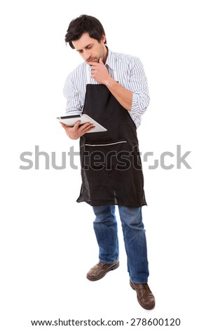 Young man searching for a new recipe over the internet