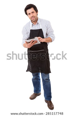 Young man searching for a new recipe over the internet - stock photo