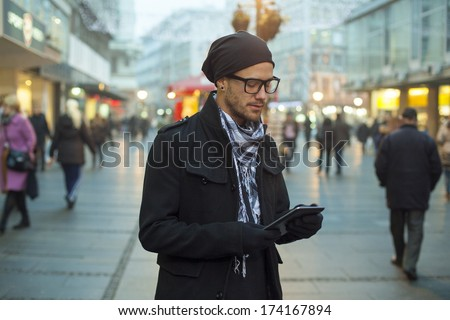 Young man searching information using an tablet computer. - stock photo