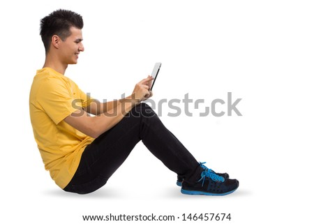 Young man seat using a tablet computer PC, isolated on white background - stock photo