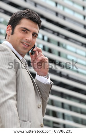 Young man setting an appointment on phone