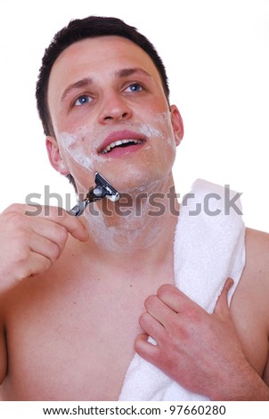 young man shaves his face