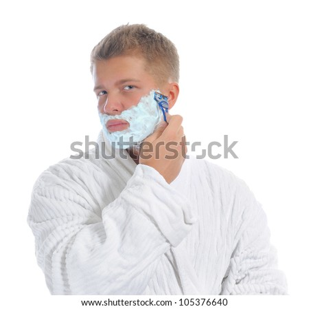 Young man shaving in the morning close-up. Isolated on a white background