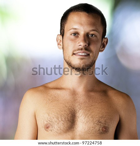 young man shirtless resting against an abstract background - stock photo
