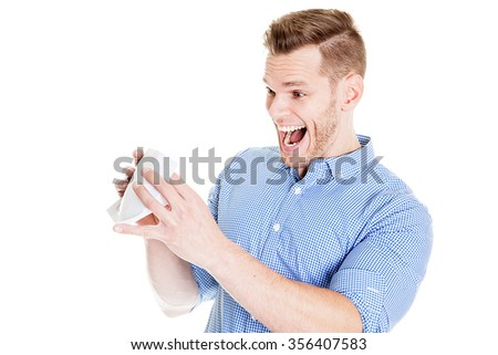 Young man shocked after opening an envelope