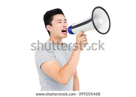 Young man shouting on horn loudspeaker on white background