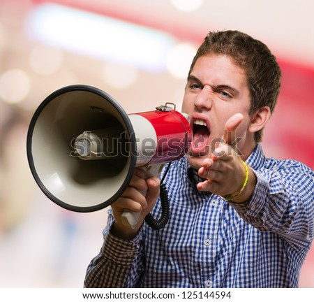 Young Man Shouting On Megaphone at a mall