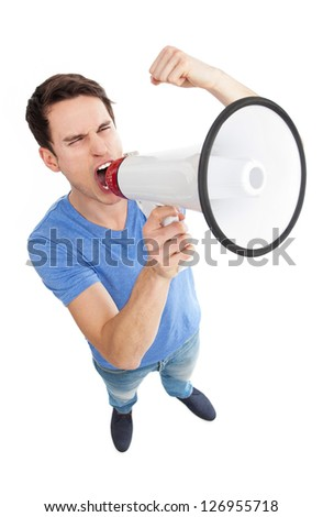 Young man shouting through megaphone - stock photo