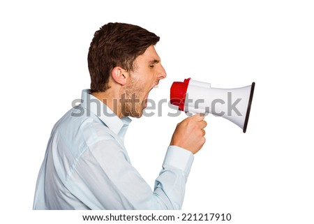 Young man shouting through megaphone on white background - stock photo