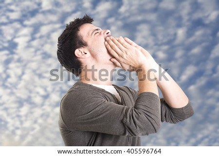 Young man shouting with hands on the mouth isolated on a white background - stock photo
