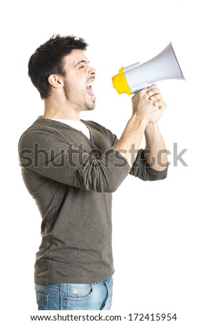 Young man shouting with megaphone on a white background - stock photo