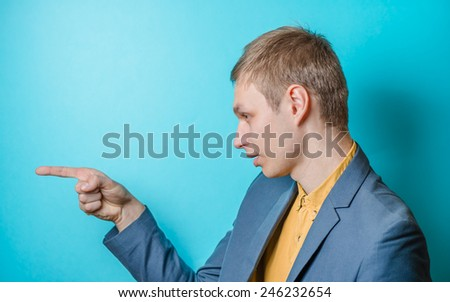 Young  man . Show someone the finger. Gesture. Photo Shoot.  - stock photo