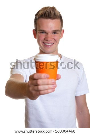 Young man showing a cup of coffee  - stock photo