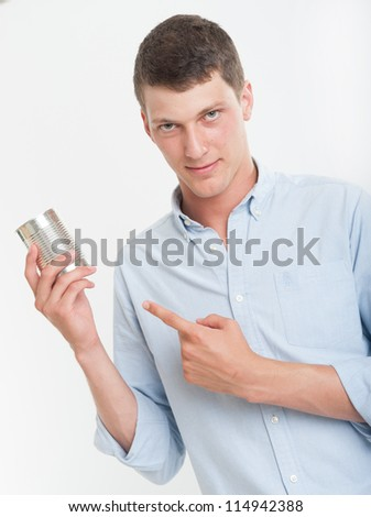 Young man showing an aluminum can - stock photo