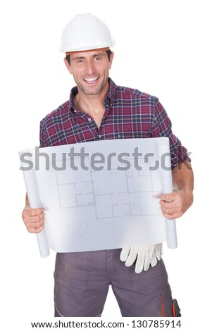 Young Man Showing Building Blueprints On White Background - stock photo