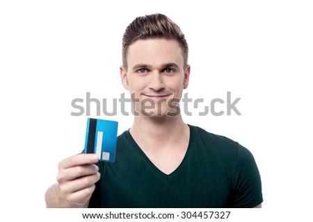 Young man showing debit card to camera