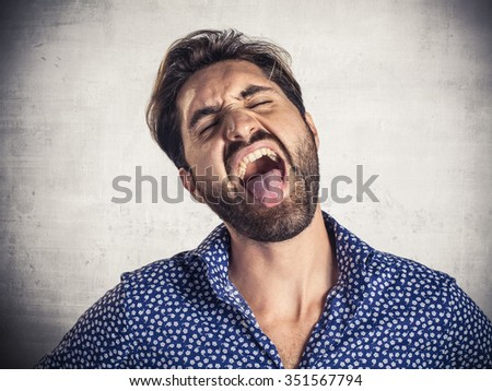 Young man showing disgusted expression - stock photo