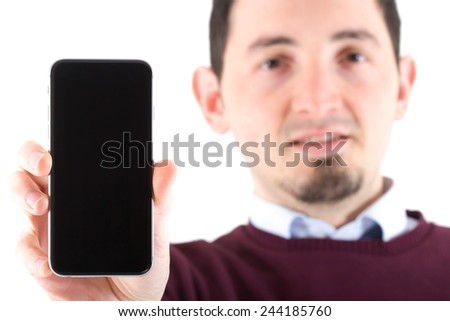 Young man showing display of mobile cell phone with black screen and smiling on a white background. Focus on hand - stock photo