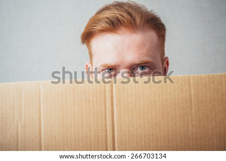 young man showing empty board - stock photo