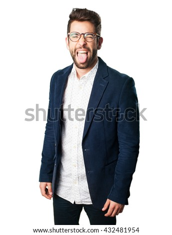 young man showing his tongue - stock photo